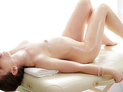 Mind-blowing black-haired lassie likes a massage screw act
